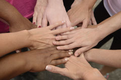 teamwork-hands-together